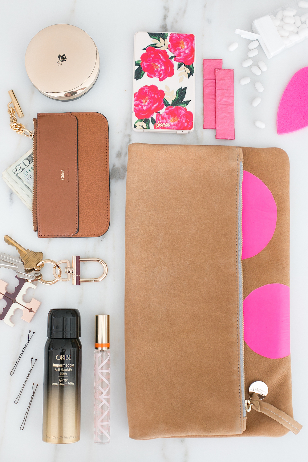 Lancome Oribe Flat Lay Chloe Clutch Essentials Make up Monika Hibbs