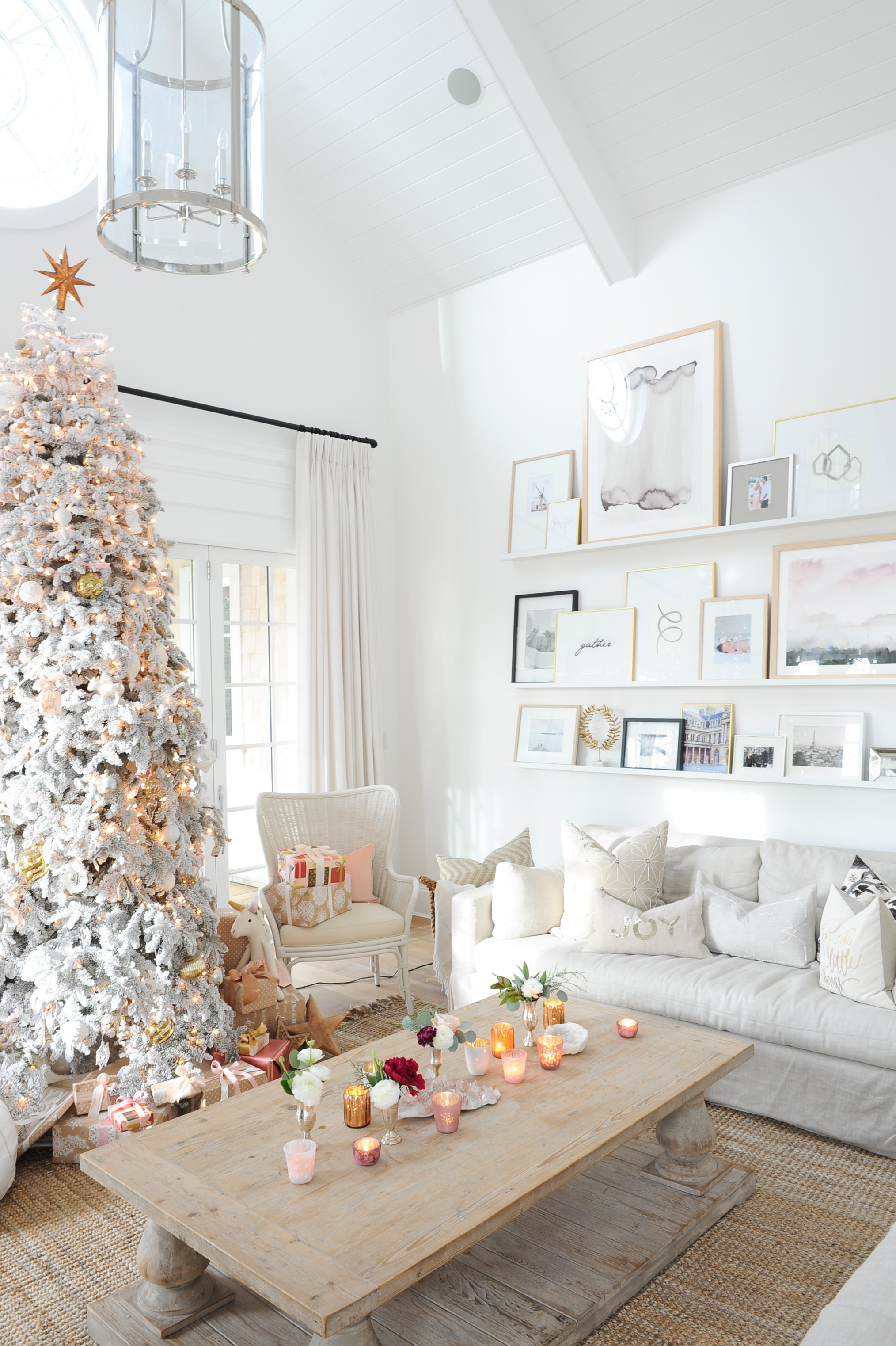 Flocked Christmas Tree in living room with gallery wall